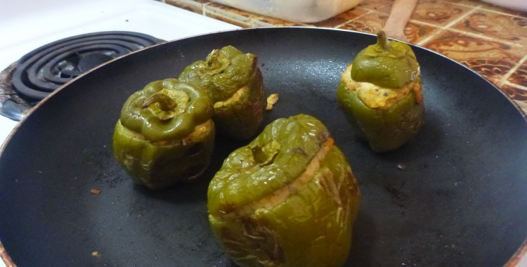Bell peppers stuffed with breadfruit, fish, and spicy peppers
