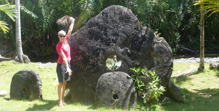 The biggest stone money we found.  It is tilted backward a bit and stuck into the ground.  This was carried on a traditional canoe back from Palau.