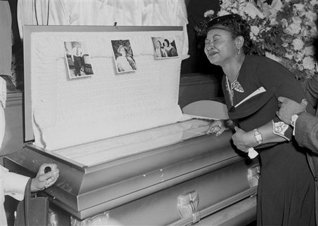 FILE - In this 1955 file photo, Mamie Mobley, mother of Emmett Till, pauses at her son's casket at a Chicago funeral home. The 14-year-old Chicagoan was killed in 1955 after reportedly whistling at a white woman during a visit to his uncle's house in Mississippi. Nearly 100,000 people visited his glass-topped casket during a four-day public viewing in Chicago. Images of his battered body helped spark the civil rights movement. On Thursday, July 9, 2009, the original casket was found at Burr Oak Cemetery in Alsip, Ill., by authorities investigating where four workers are accused of digging up bodies to resell plots. Till's grave site was not disturbed. When Till was exhumed in 2005 during an investigation of his death, he was reburied in a new casket. The original casket was supposed to be kept for a planned memorial to Till. (AP Photo/Chicago Sun-Times, File) **CHICAGO LOCALS OUT, MAGS OUT**